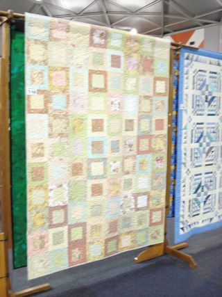 My scrappy quilt hung at 2Q exhibition 2